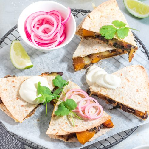 These cheesy pumpkin quesadillas may not look the prettiest but don't let that put you off. 