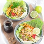 Tasty pork and veggies with noodles, roasted peanuts and a sweet chilli soy dressing, all wrapped up in a big lettuce leaf. These pork lettuce cups are a fun and delicious weeknight meal!