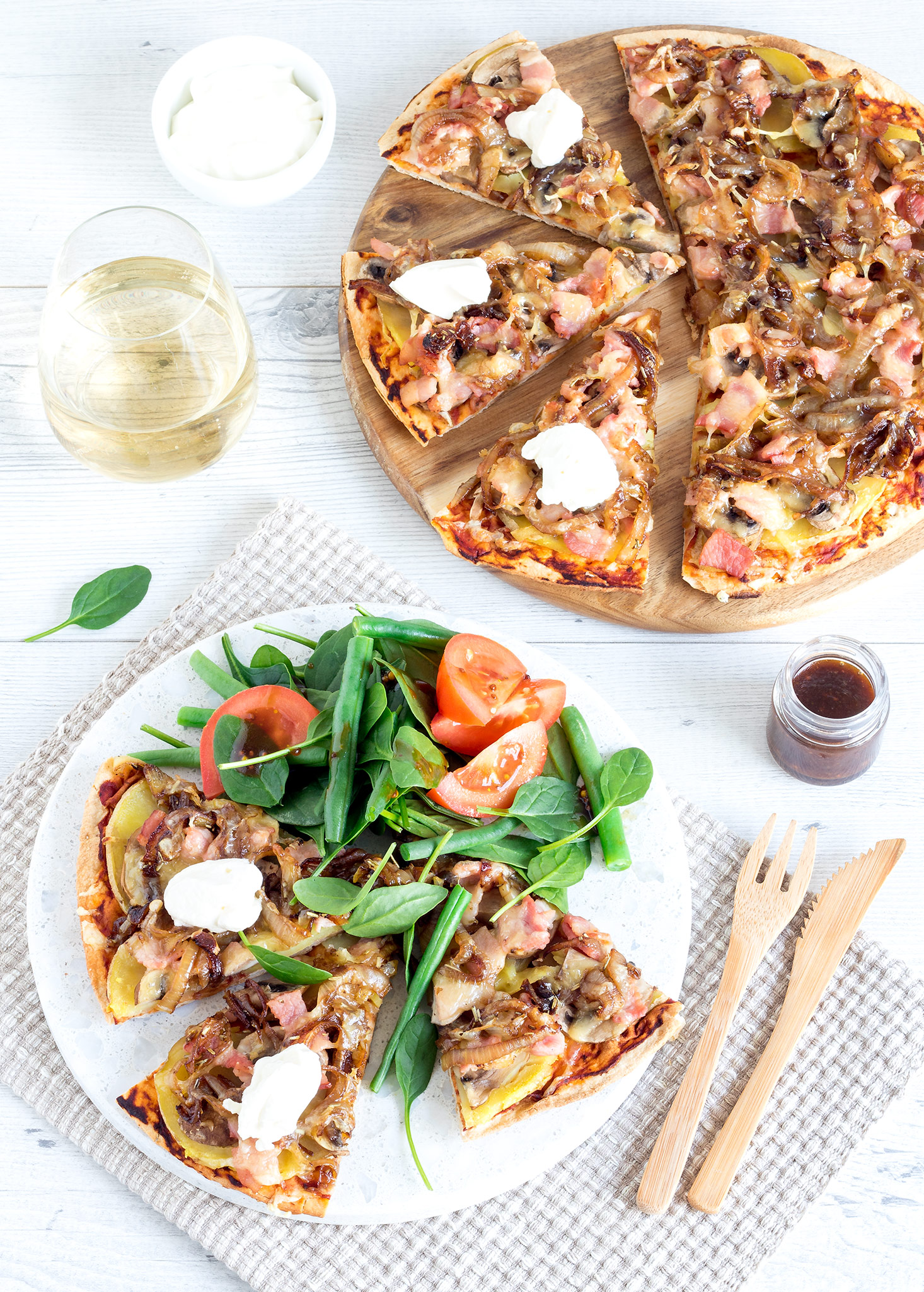 Who doesn't love a pizza? With bacon, potato, caramelised onions and dollops of sour cream, these country-style pizzas are a good hearty meal!