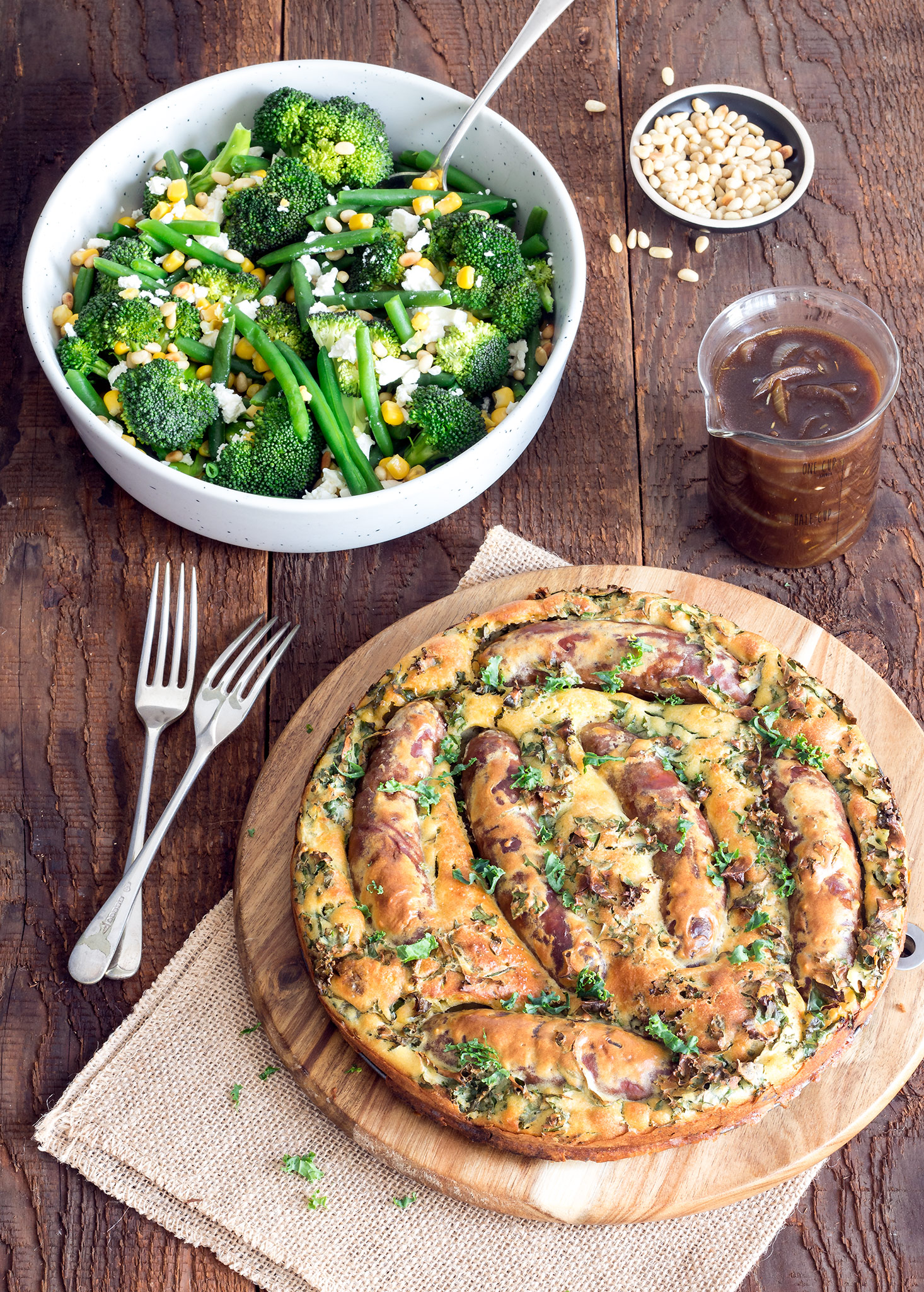 Toad in the hole is the perfect winter warming meal. Step it up a notch with caramelised onion gravy and steamed veggies topped with feta and pinenuts.