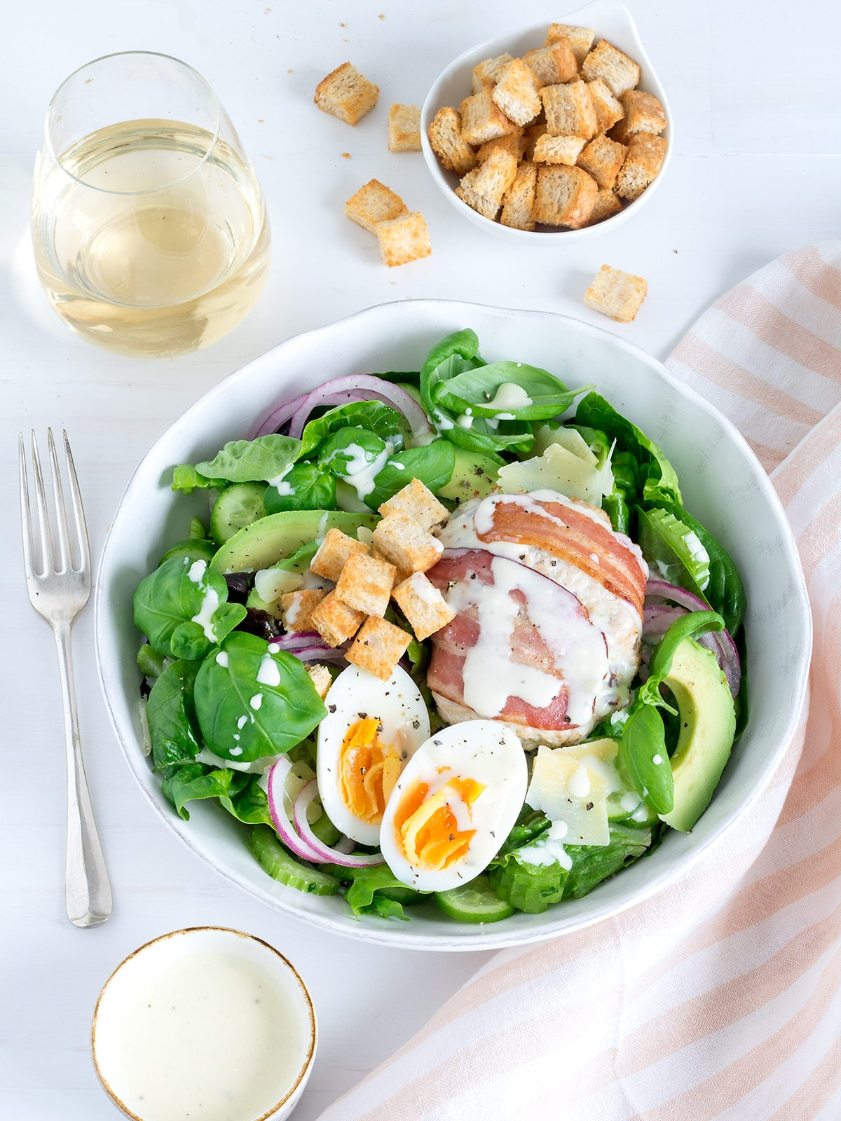 These chicken caesar burger bowls are a jazzed up version of caesar salad. I've thrown in a few extra veggies for more nutrition and flavour. This is a really yummy, lower carb dinner.