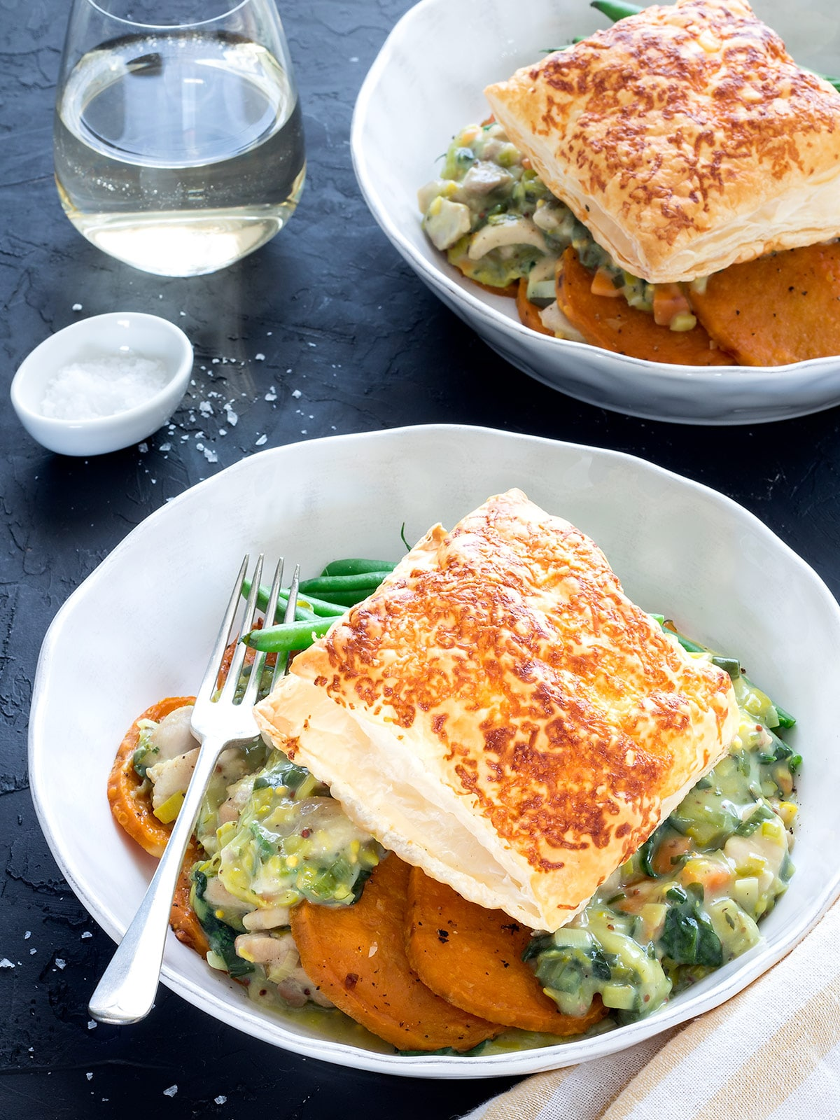 Easy chicken and leek pie is such great comfort food. This deconstructed version has kumara rounds for the base and a cheesy pastry topper.