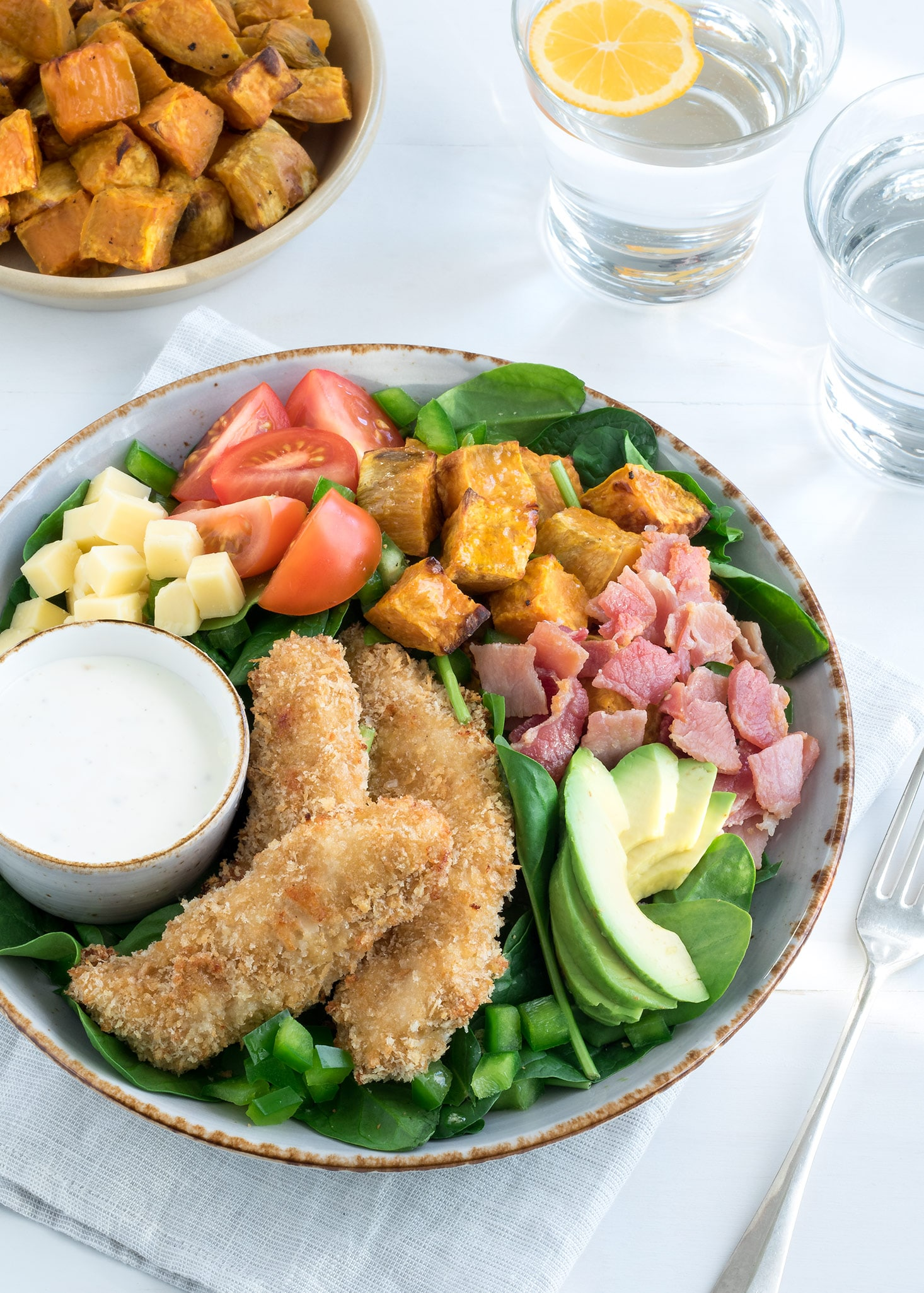 Crunchy crumbed chicken tenders served on a salad packed with tasty ingredients. This is a really yummy meal that still has decent nutritional value.