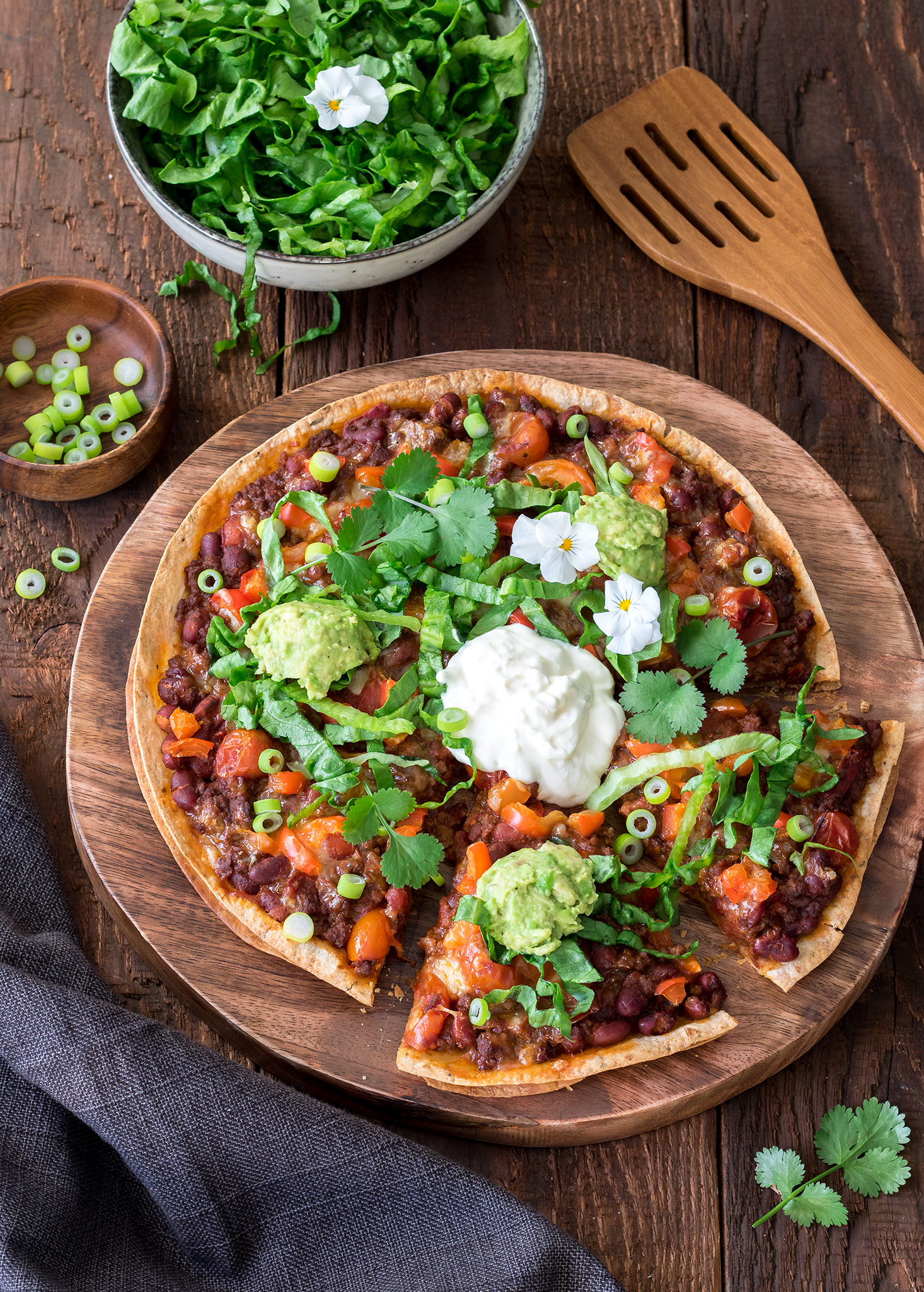These Mexican-style pizzas are more Tex-Mex than authentic Mexican, but super tasty anyway! They're really easy to prepare, and the wraps make a nice light alternative to regular pizza bases.