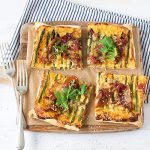 Asparagus and prosciutto tart is such a flavoursome, easy dinner. It's a great option for a dinner party too - just cut the baked tart into smaller squares.