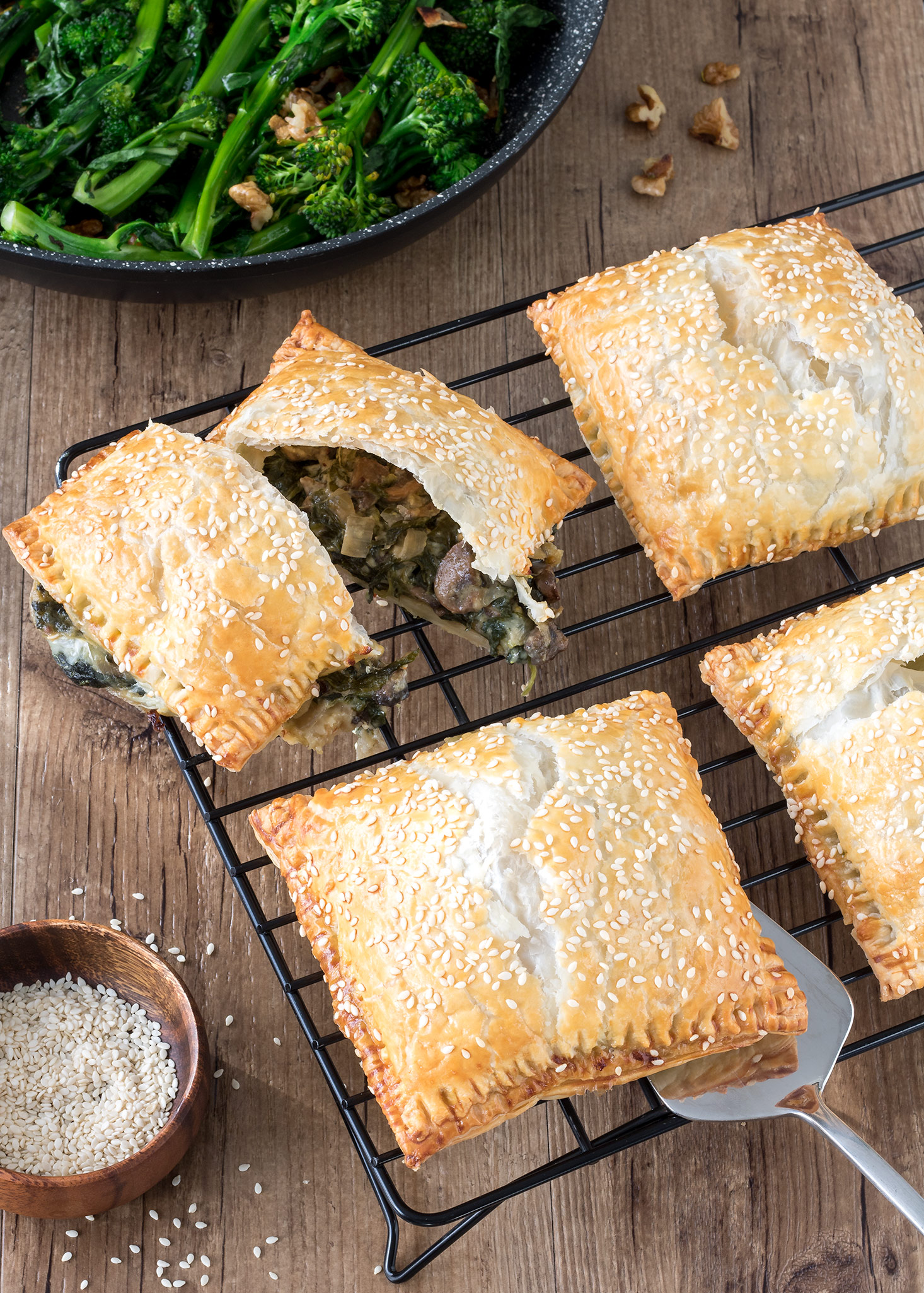 Who doesn't love a good pie?! These individual creamy mushroom and spinach pies with buttery puff pastry are a delicious vegetarian meal. Sautéed broccolini makes a great accompaniment.