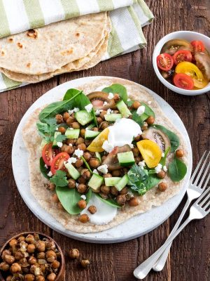 Curried chickpeas on roti are a flavoursome Indian-style vegetarian meal. You can easily adjust the spice level to your liking, and store-bought roti or wraps help to make this a quick and easy dinner.