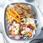 Dukkah crusted chicken with kumara fries and tomato and feta salad - this meal is packed with exciting flavours! Homemade dukkah is super easy to make and tastes so good fresh!