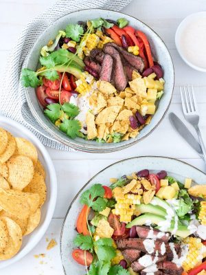 Corn chips add a delicious, crunchy texture to these moreish Mexican beef salads. Super easy to make and packed with flavour, they are sure to become a family favourite.