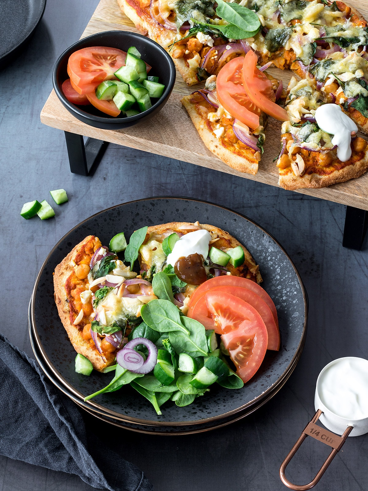 Indian-spiced tandoori chickpea pizzas are a moreish vegetarian meal. Naan bread provides a sturdy base for all the toppings. Don't forget a dollop of yoghurt and chutney - this finishes the pizzas off perfectly!