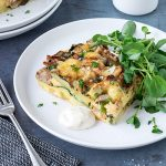 This sausage, brie and caramelised leek frittata is just a little gourmet, and very filling. It isn't the quickest of meals to prepare, but you'll have plenty of time to get all the cleaning up done while it bakes.