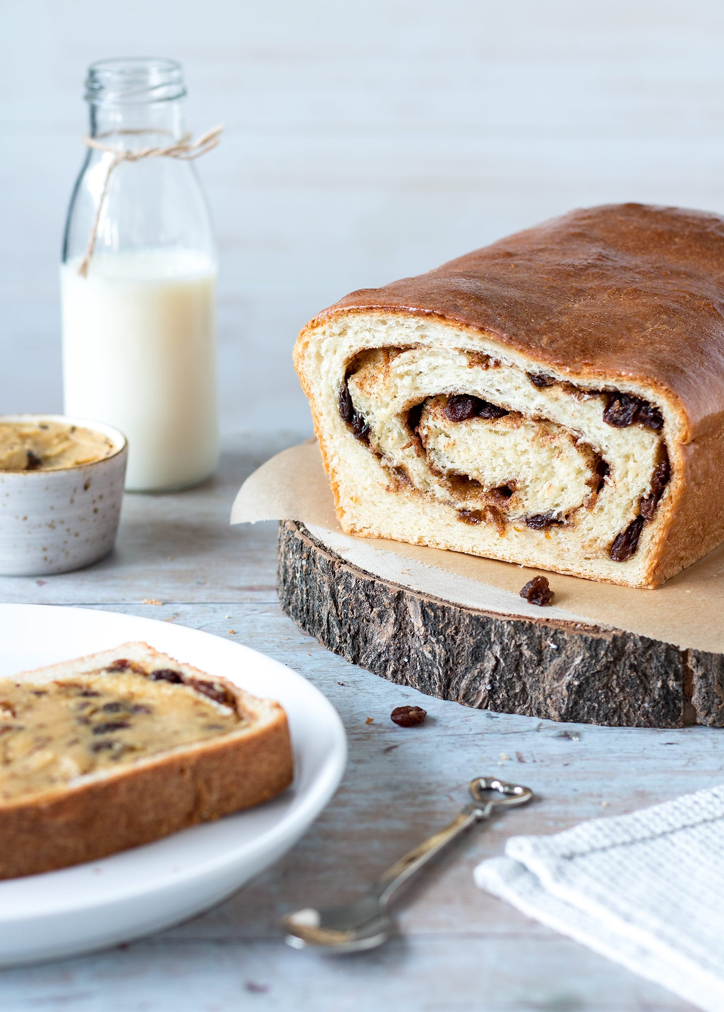 This spiced Easter loaf is filled with a cinnamon fruit swirl and served with deliciously moreish flavoured butter. An exciting, easy twist on hot cross buns that is just as good turned into French toast the next day!