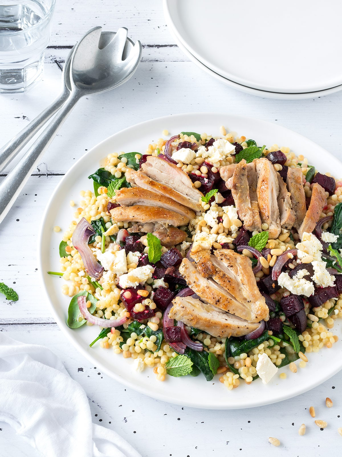 Plate of chicken, roasted beetroot and feta salad.