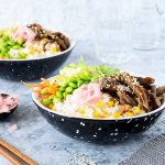 Two bowls of Japanese teriyaki beef.