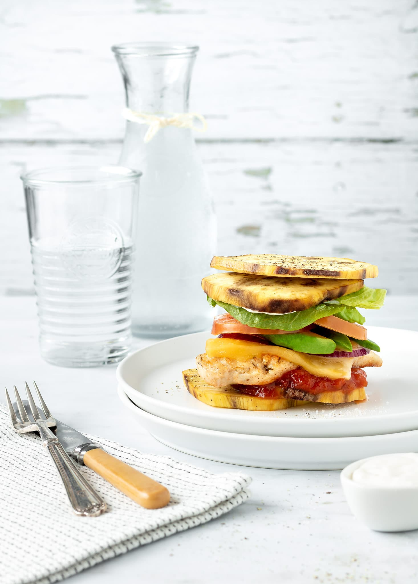 Chicken burger stack on a plate.