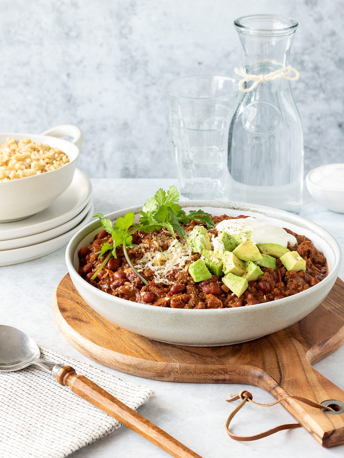 Bowl of chilli con carne loaded up with toppings.