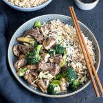 Bowl of beef and broccoli stir fry with rice.
