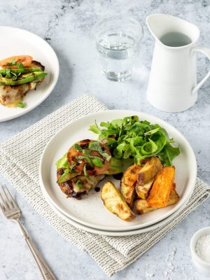 Plate of California chicken with kumara wedges and rocket.