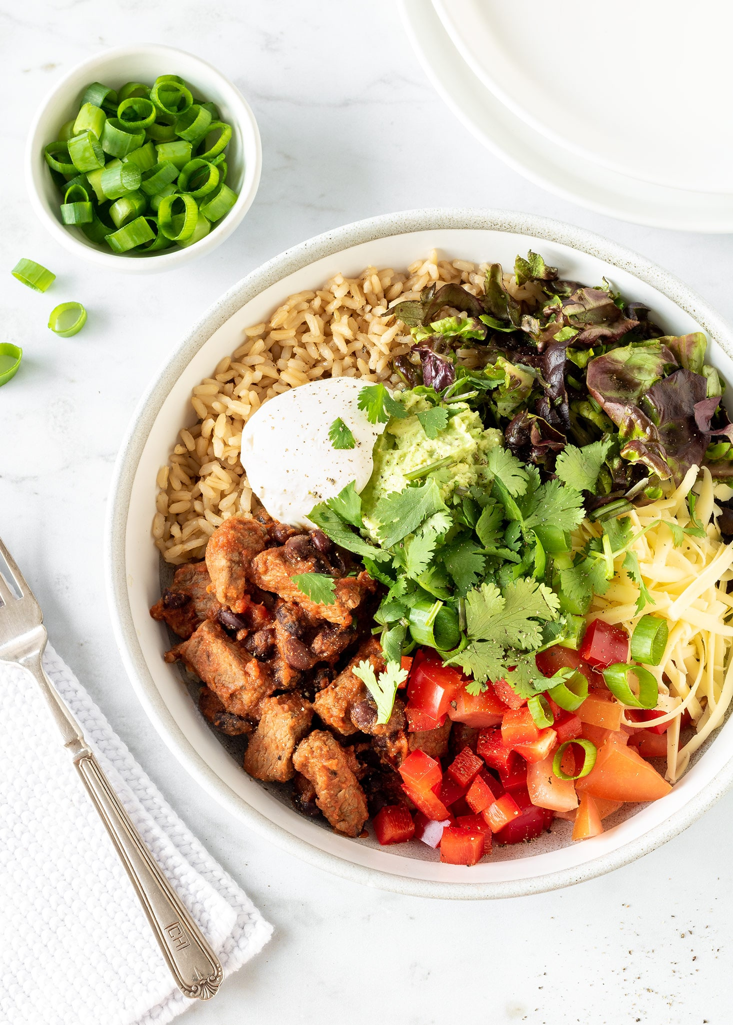 Steak burrito bowls with lots of salad.