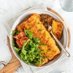 Beef and mushroom cannelloni with salad.