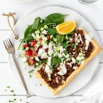 Greek lamb tart with salad.