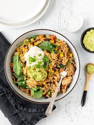 Mexican fried rice with chicken, cheese, guacamole and sour cream.