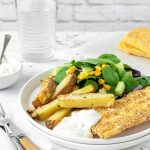 Polenta crumbed fish with chunky chips, salad and tartare sauce.