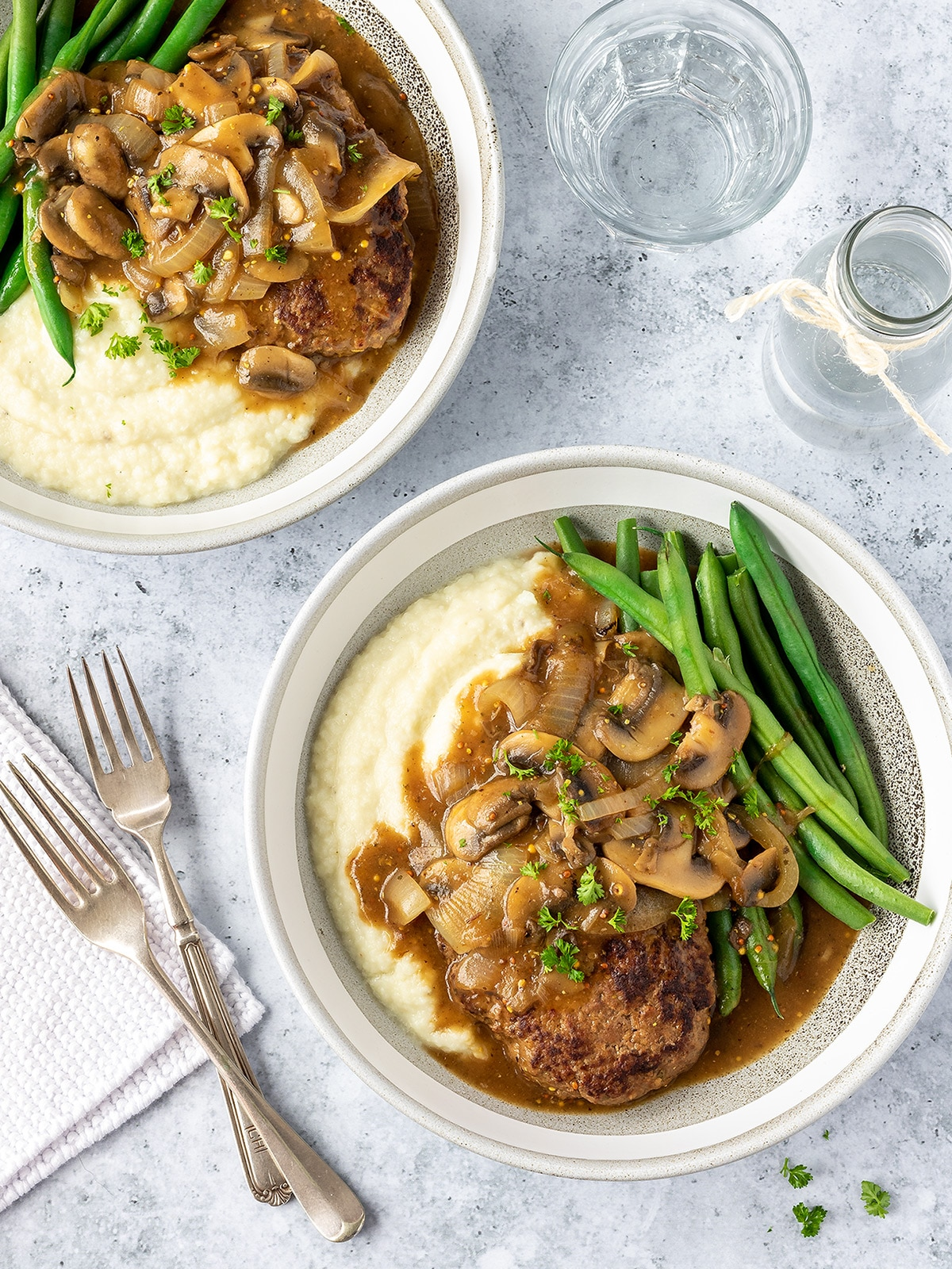 Salisbury steak with mushroom gravy, cauliflower mash and green beans.