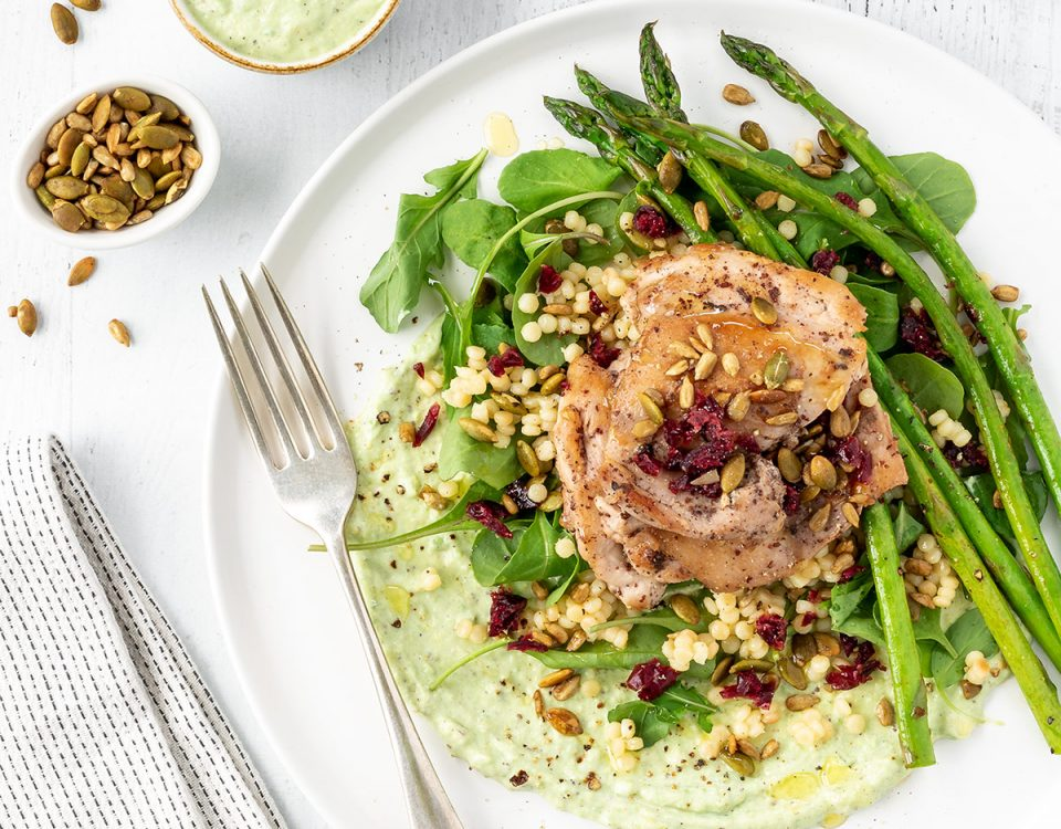 Ultimate spring salad with chicken, asparagus, pearl couscous, cranberries and a creamy avocado dressing.