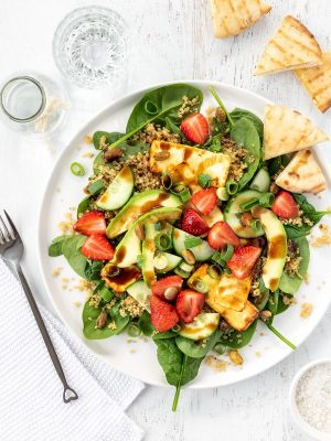 Baked feta and strawberry salad with quinoa, pistachios, avocado and garlic pitas.