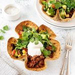 Taco salad bowls with sour cream and coriander.