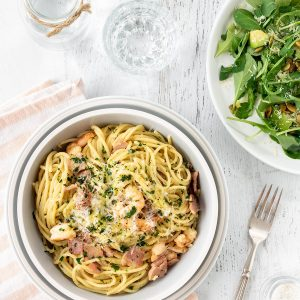 Bacon and prawn spaghetti with rocket, avocado and pumpkin seed salad.