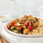Chinese chicken stir fry with brown rice, veggies and sesame seeds.