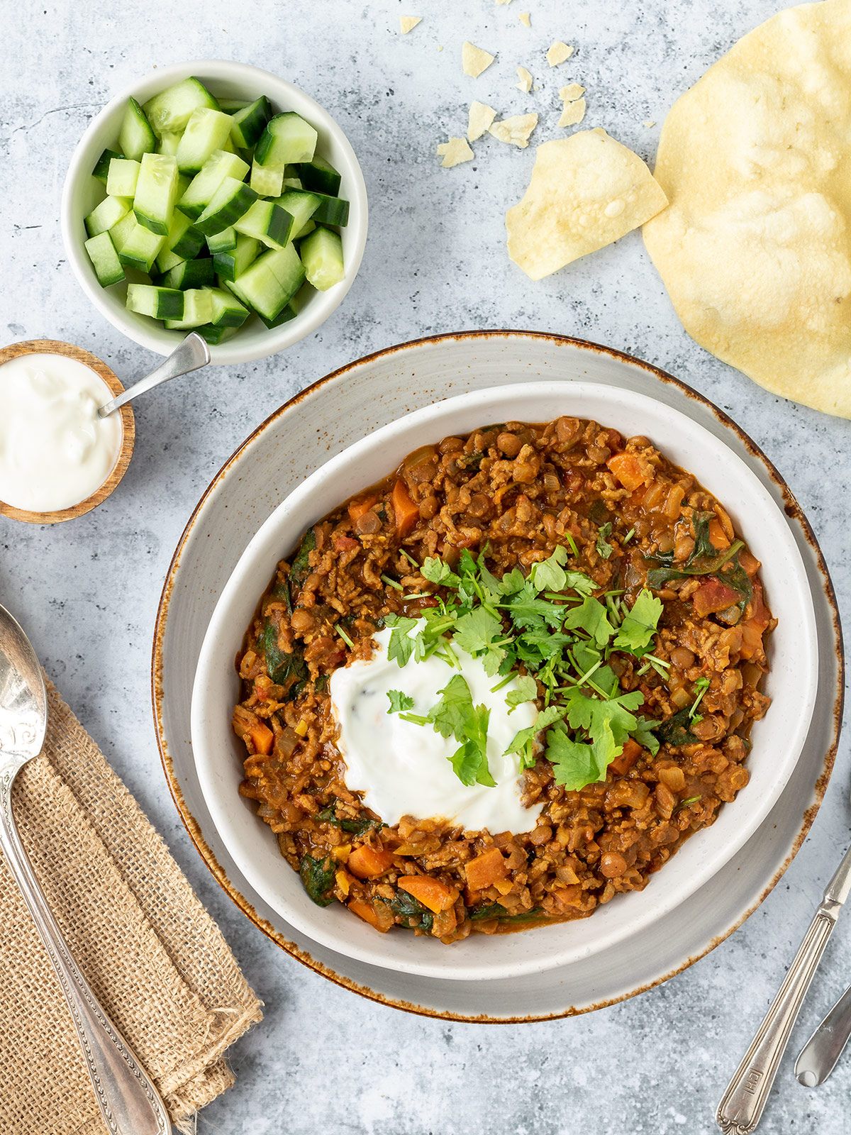 Curried mince with cucumber, yoghurt, coriander and pappadums.