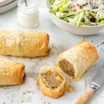 Filo pastry sausage rolls with a crisp salad and creamy dressing.