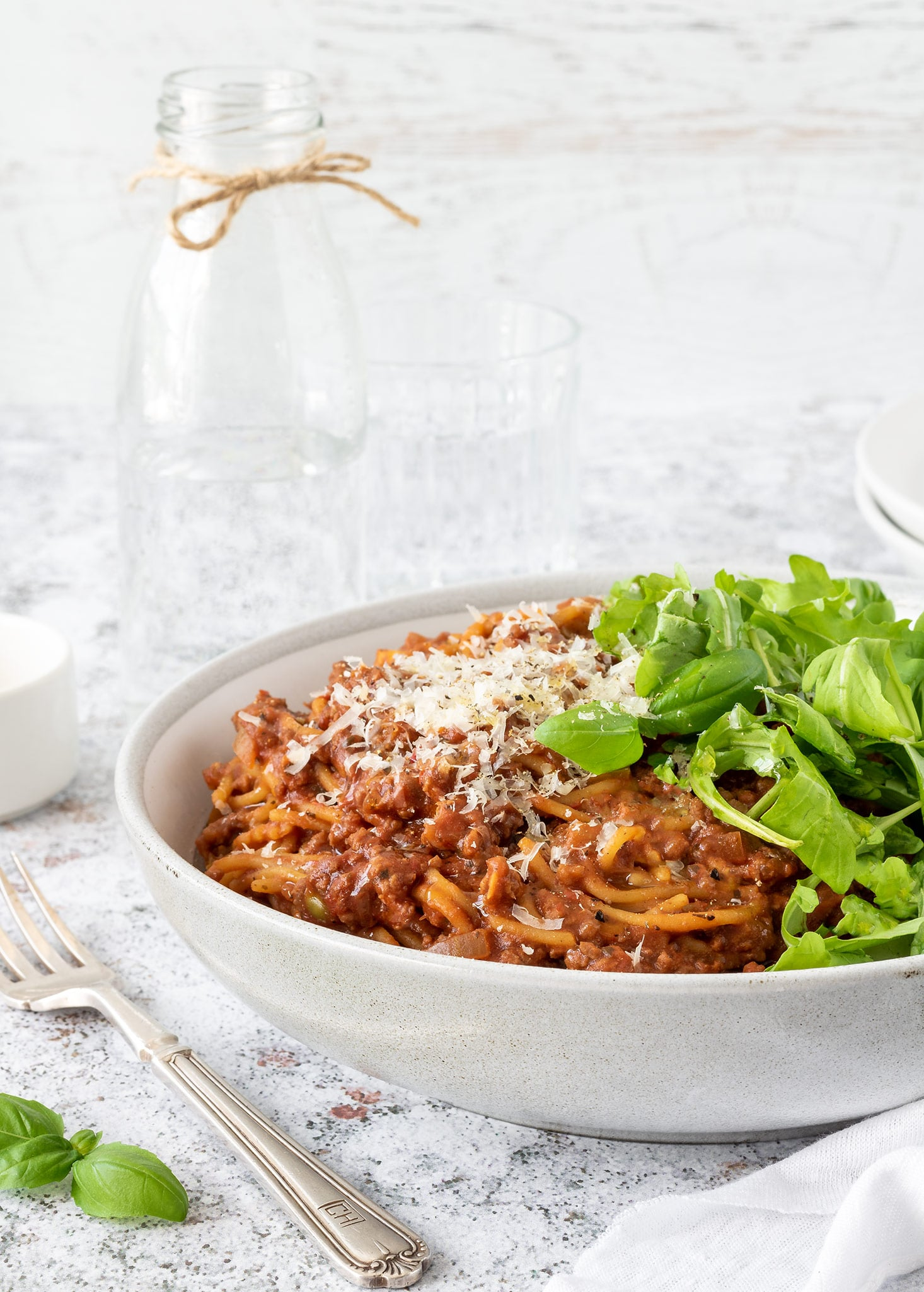Spaghetti bolognese with parmesan and rocket.