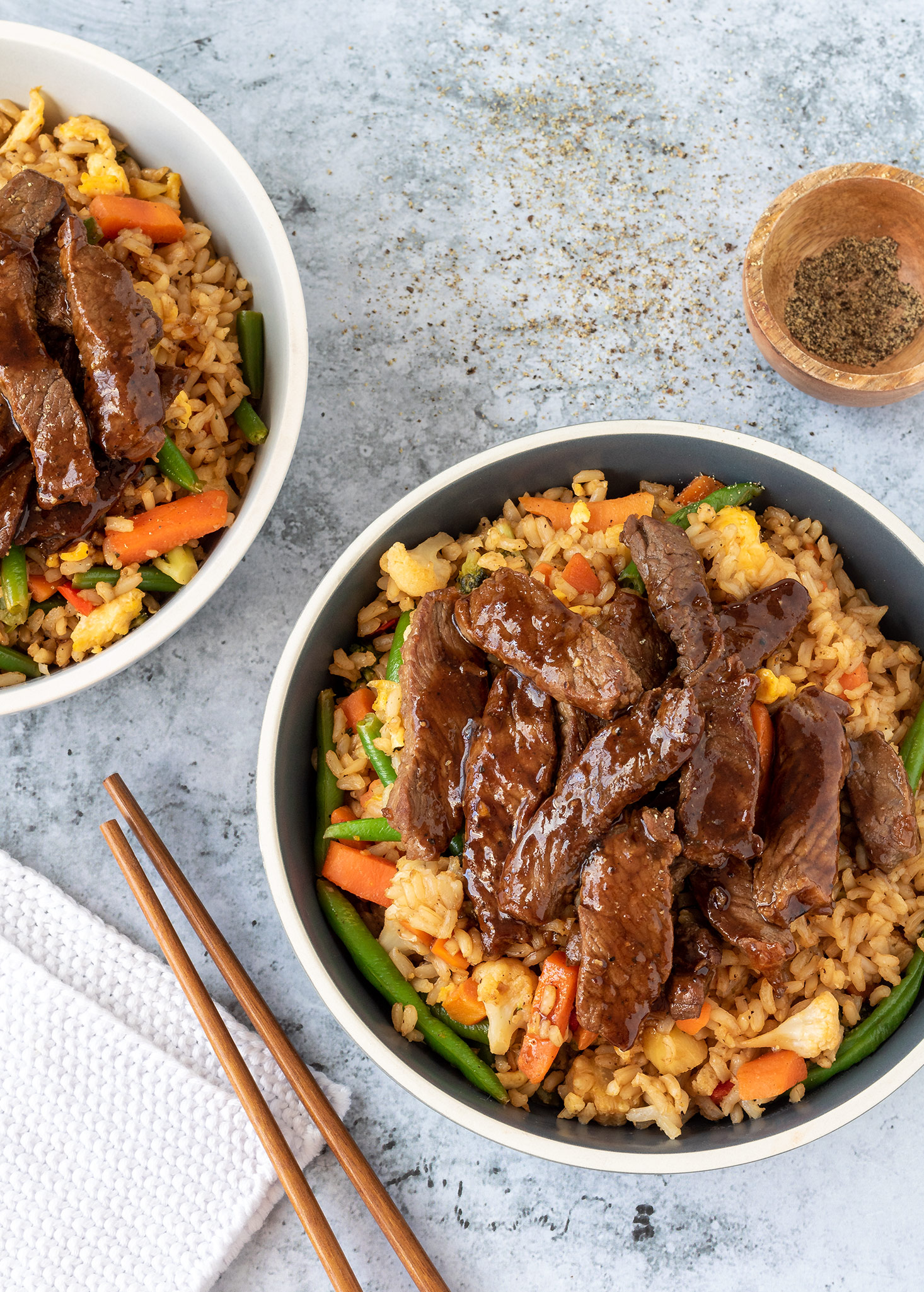 Black pepper beef with fried rice and veggies.