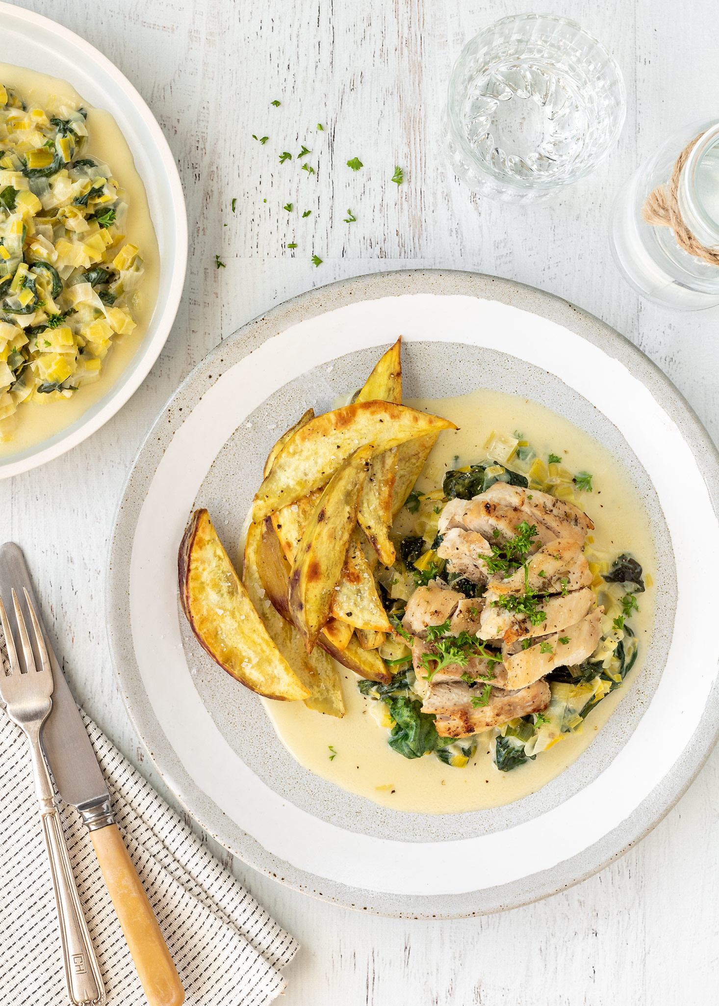 Chicken on creamy leeks and spinach with kumara wedges.
