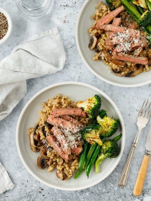 Pearl couscous risotto with mushrooms, steak and green veggies.