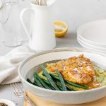 Pork with creamy mustard sauce, veggie smash and green beans.