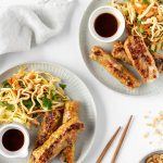 Crispy rice paper rolls with Asian slaw and hoisin dipping sauce.