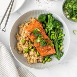 Honey garlic salmon with brown rice, broccolini and edamame.