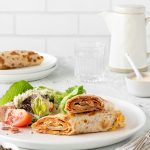 Eggy pizza wraps with crunchy cos, tomato and parmesan salad.