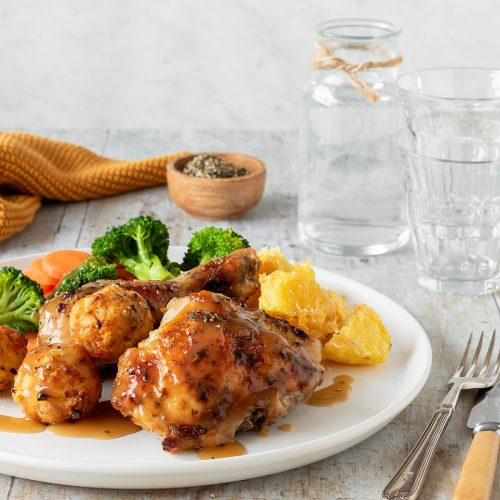 Easy roast chicken pieces with crispy roast potatoes, stuffing balls, broccoli and carrots.