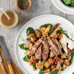 Steak salad with spinach, red onion, roast veggies, almonds and a creamy nut dressing.