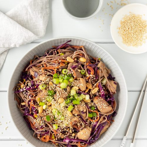 Teriyaki chicken noodles with peanuts, sesame seeds and spring onions.