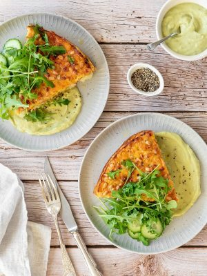 Chicken frittata with avocado sauce and a side salad.
