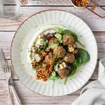 Middle Eastern meatballs with cauliflower puree, eggplant, spinach and sundried tomato dip.