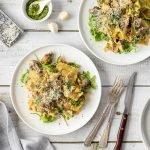Pesto ravioli with rocket, mushrooms and parmesan.