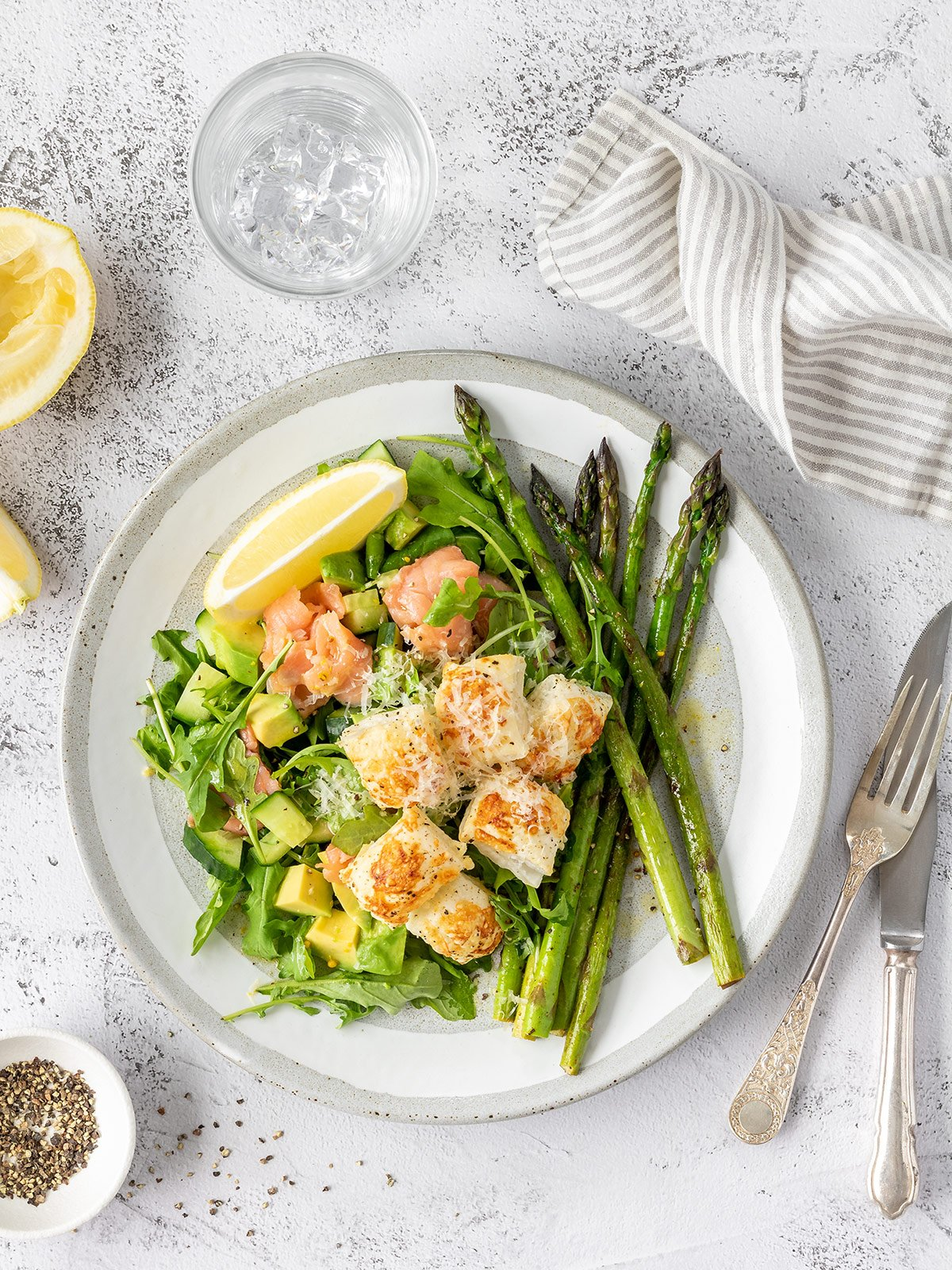Smoked salmon salad with avocado, cucumber, asparagus and parmesan puff pastry croutons.